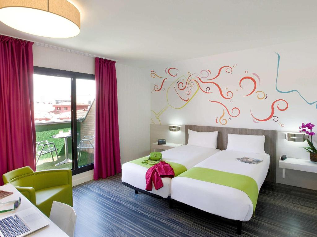 A bed or beds in a room at Ibis Styles Madrid Prado