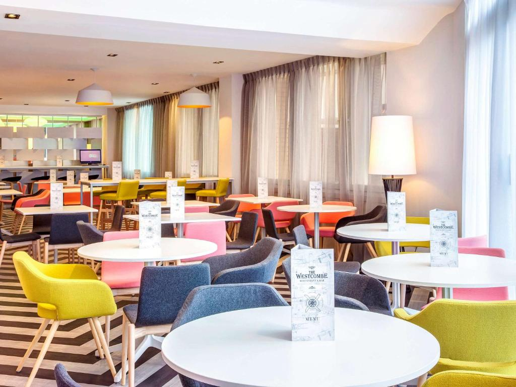 A restaurant or other place to eat at ibis Styles London Heathrow Airport