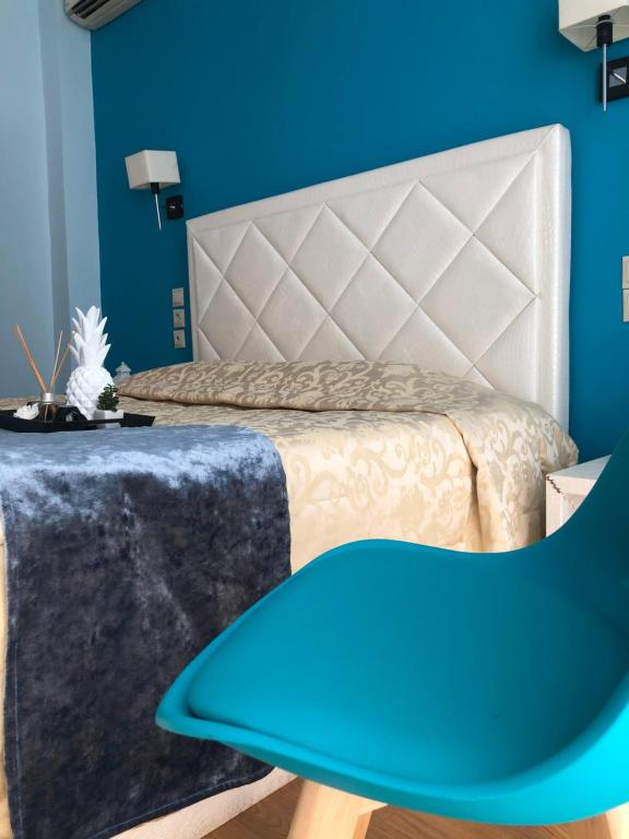 A bed or beds in a room at Hotel Rodini