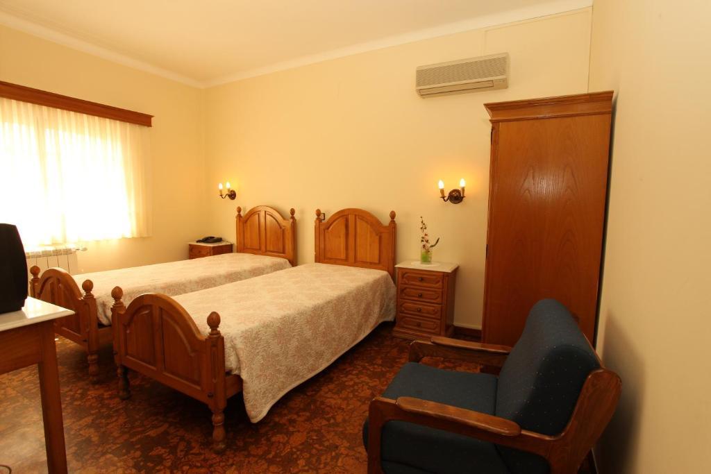 Cama o camas de una habitación en Residencial Sra. da Lomba