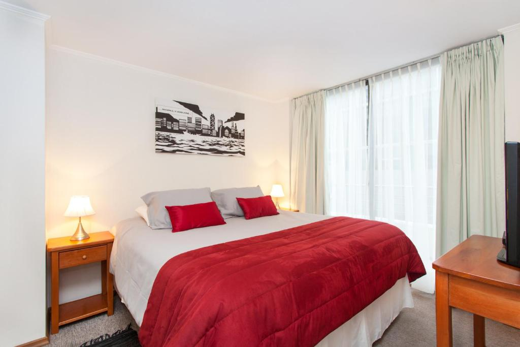 A bed or beds in a room at Bellavista Apartments