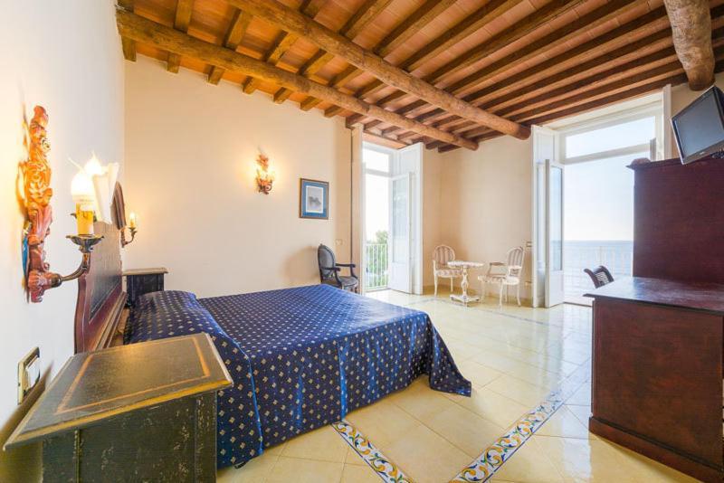 Кровать или кровати в номере Villa Isabella