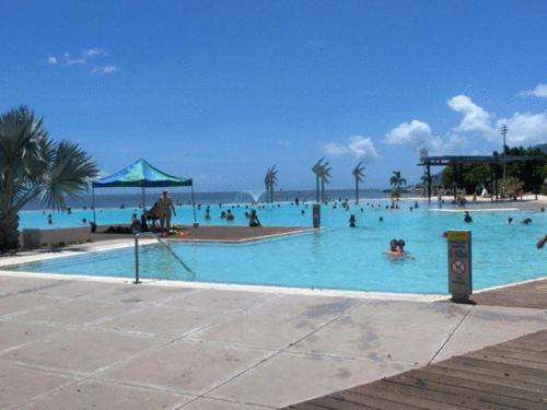 The swimming pool at or near Cairns Waterfront Backpackers