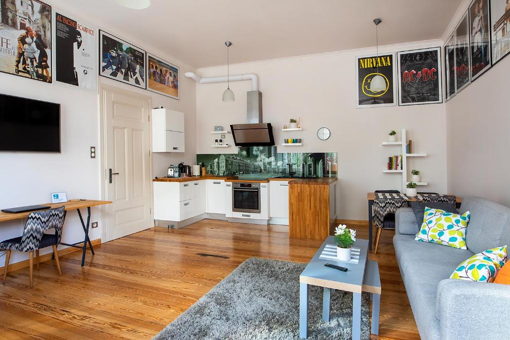 A kitchen or kitchenette at Movie Apartment Jeżyce