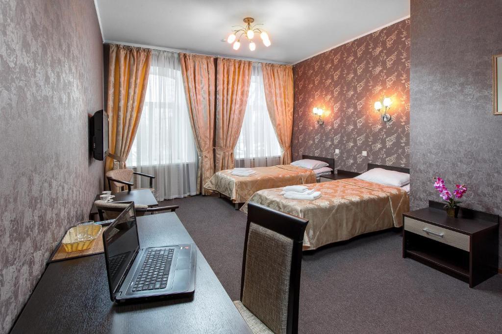 Кровать или кровати в номере Отель Самара Люкс