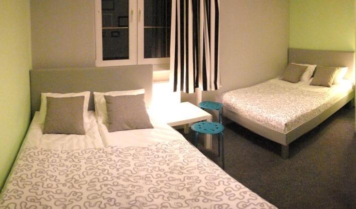 Łóżko lub łóżka w pokoju w obiekcie Olive Hostel