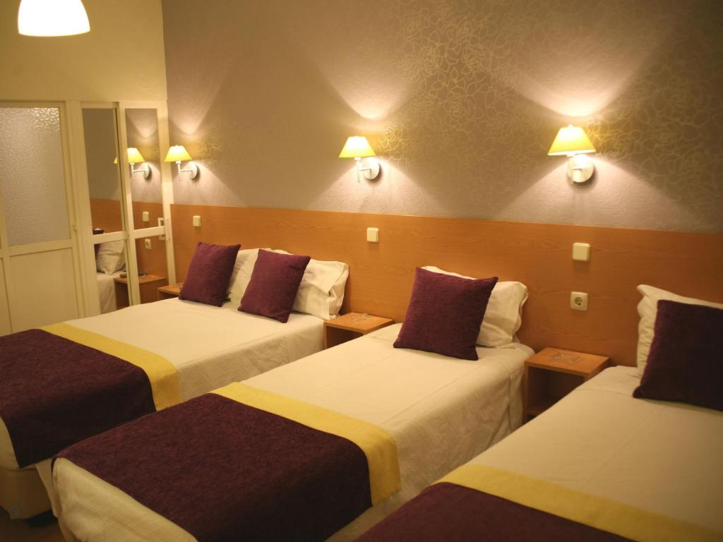 A bed or beds in a room at Estrela dos Anjos