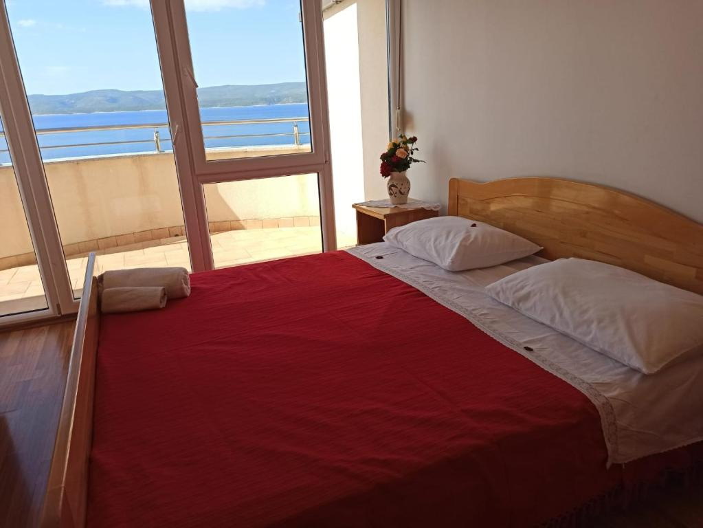 A bed or beds in a room at Villa Venera Mimice