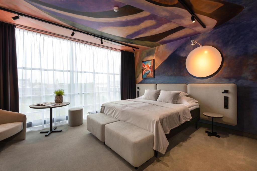 Voodi või voodid majutusasutuse Art Hotel Pallas by Tartuhotels toas
