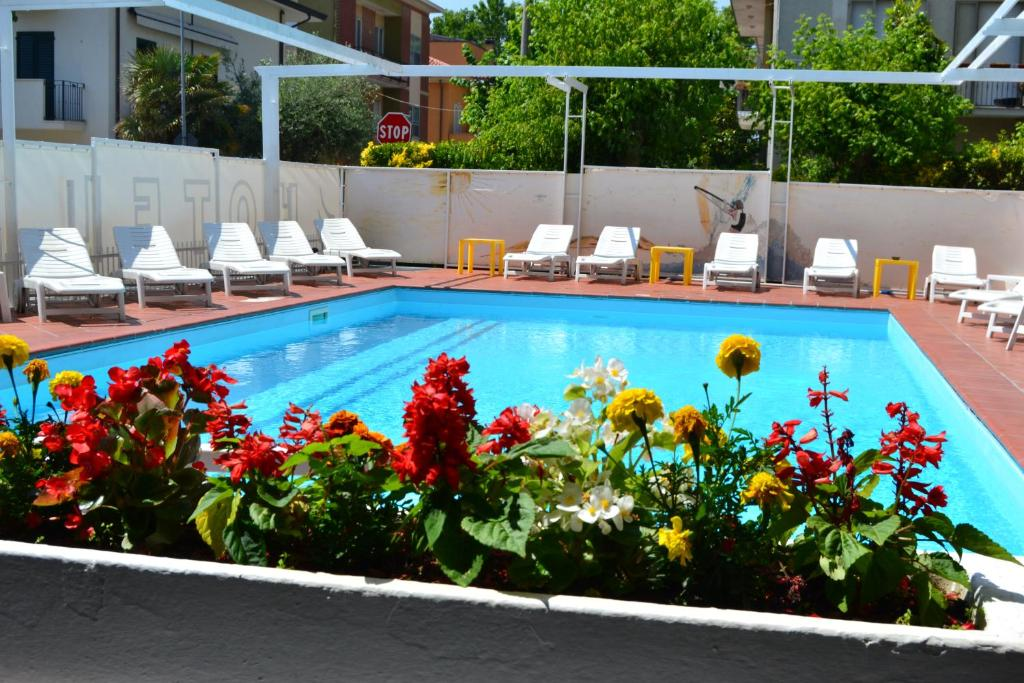 The swimming pool at or near Hotel Apis