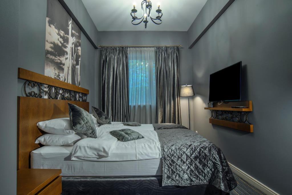 A bed or beds in a room at Badagoni Boutique Hotel Rustaveli
