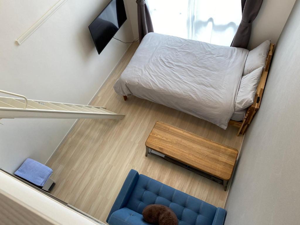 Hotel Tomas Makiminatoにあるベッド