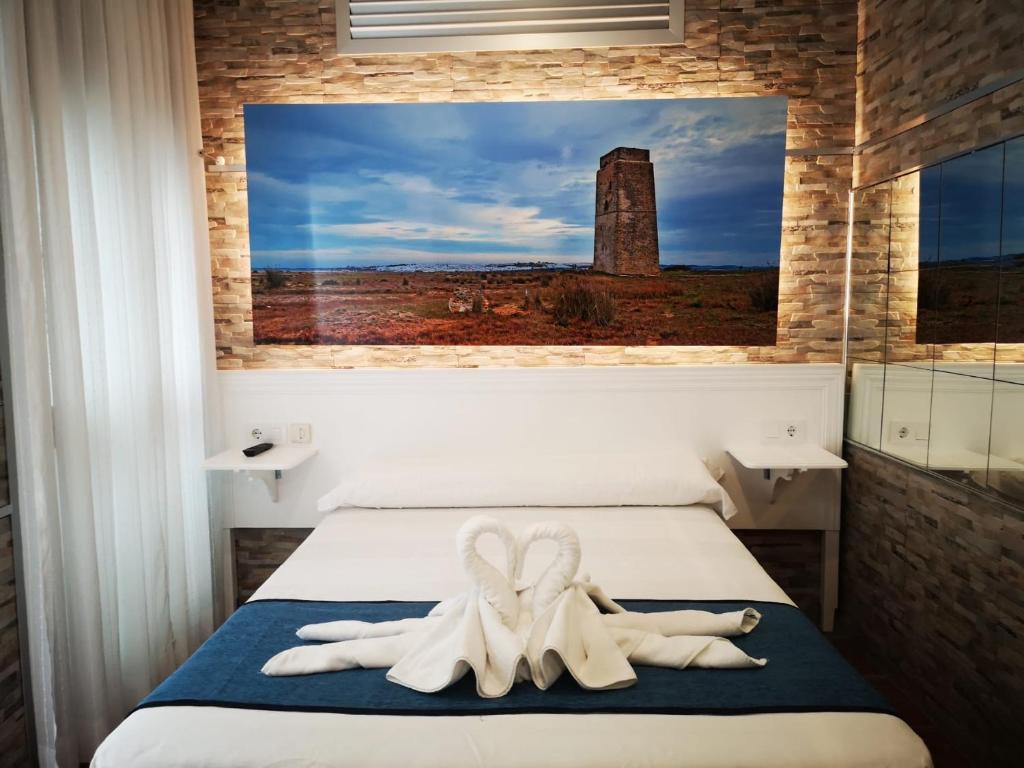 A bed or beds in a room at Hostal Costa De La Luz