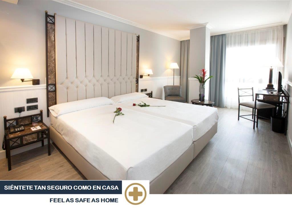 Hotel Gran Viaにあるベッド