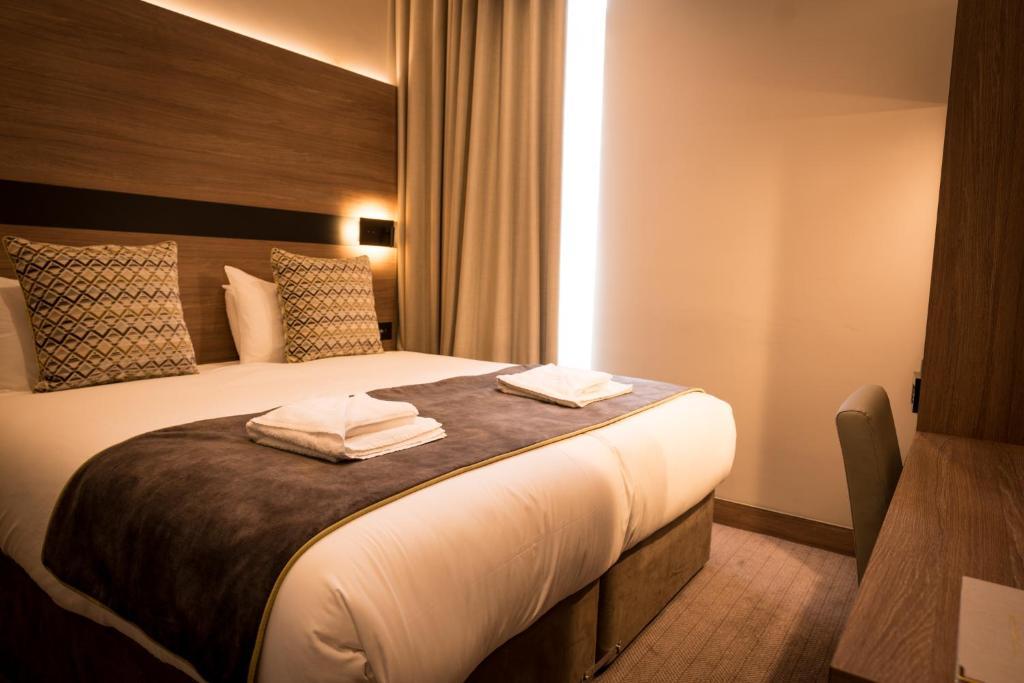 Cama o camas de una habitación en Oxford Hotel