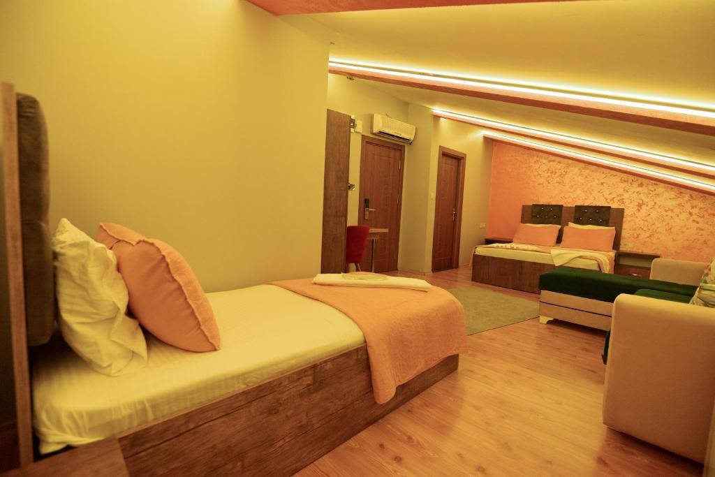 Кровать или кровати в номере Rays Otel