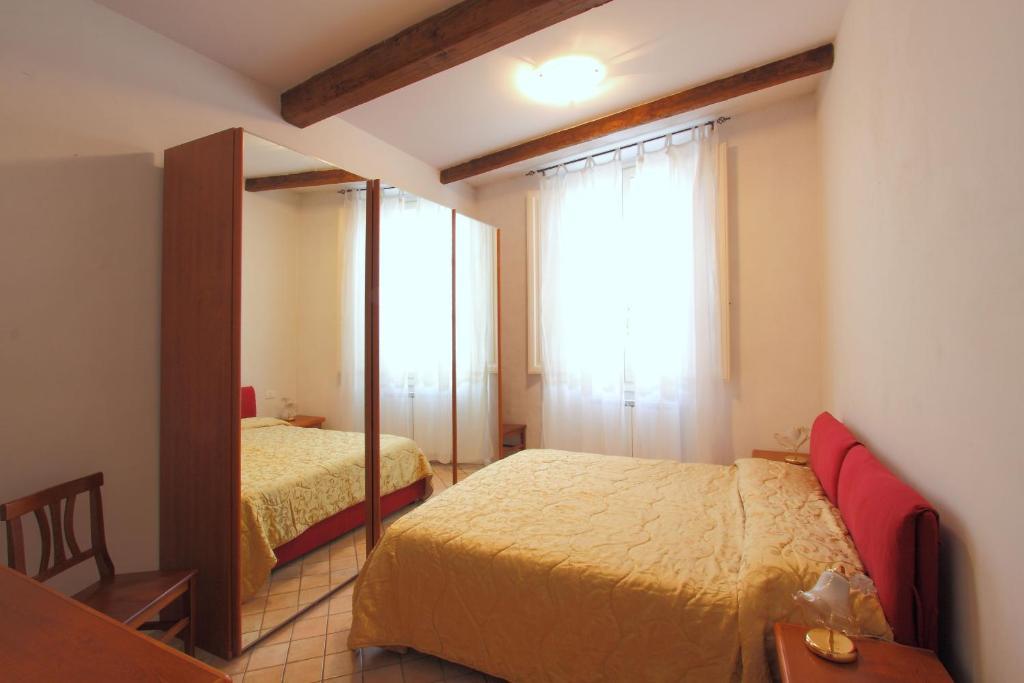 Cama ou camas em um quarto em Affittacamere Graziano