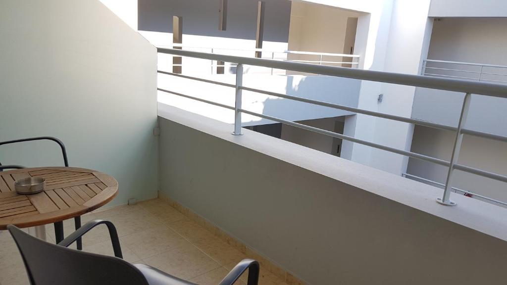 Een balkon of terras bij Cosmos Hotel