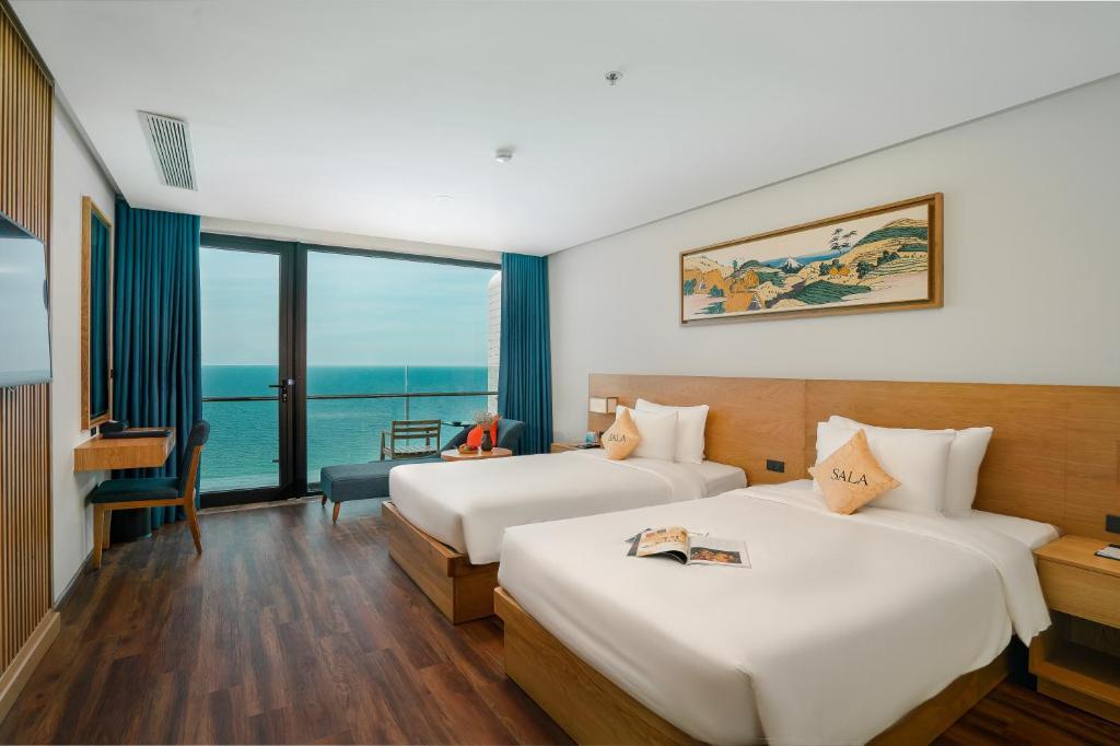 Phòng Deluxe 2 Giường Đơn có Ban công và Nhìn ra Biển