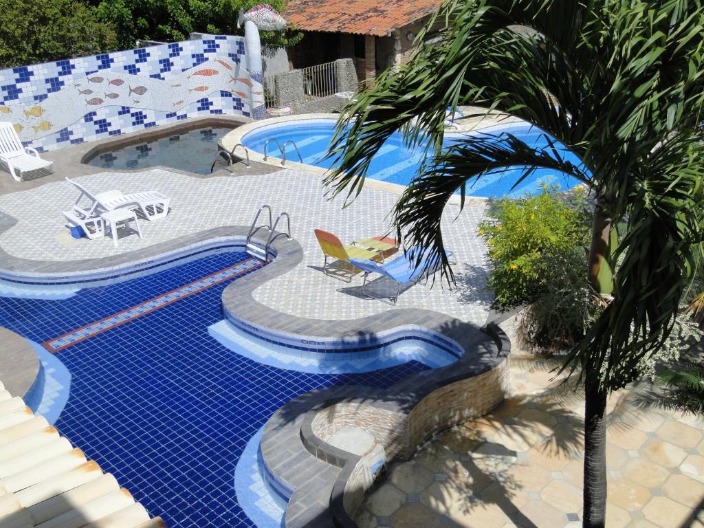 Utsikt över poolen vid Estalagem Aldeia dos Ventos eller i närheten
