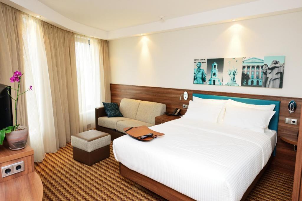 Кровать или кровати в номере Отель Hampton by Hilton Воронеж
