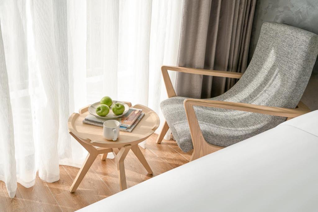 Phòng Deluxe 2 Giường Đơn Có Ban Công Và Tầm Nhìn Ra Biển