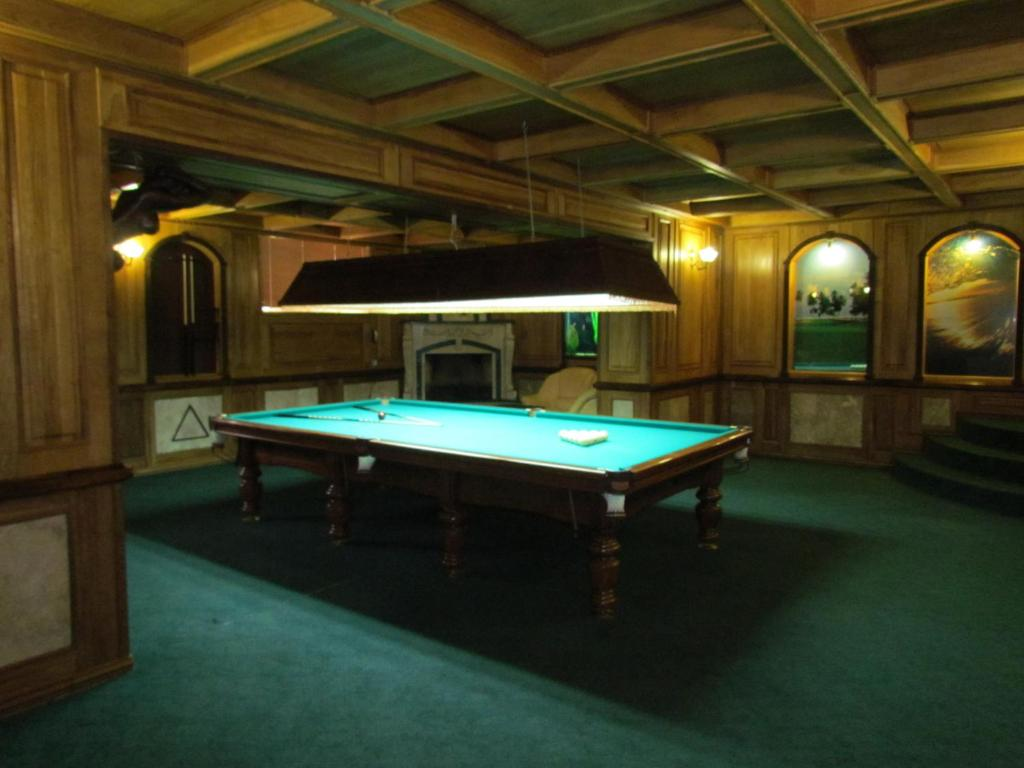 A pool table at Lesnaya Dacha