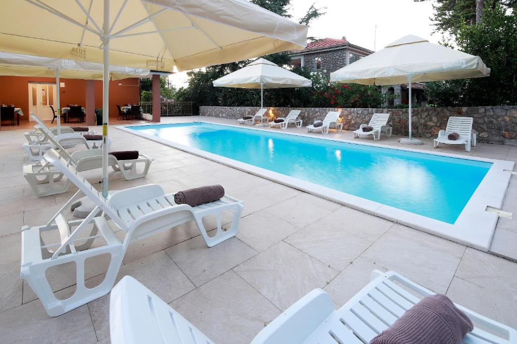The swimming pool at or near Pension Riviera-Šilo