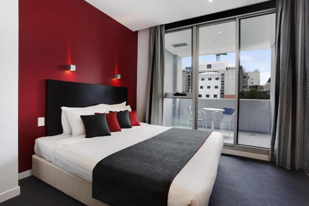 A bed or beds in a room at Adara Richmond