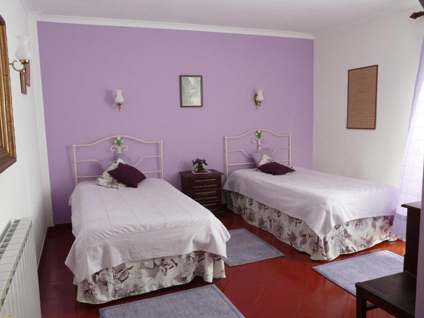 A bed or beds in a room at Casa do Patriarca