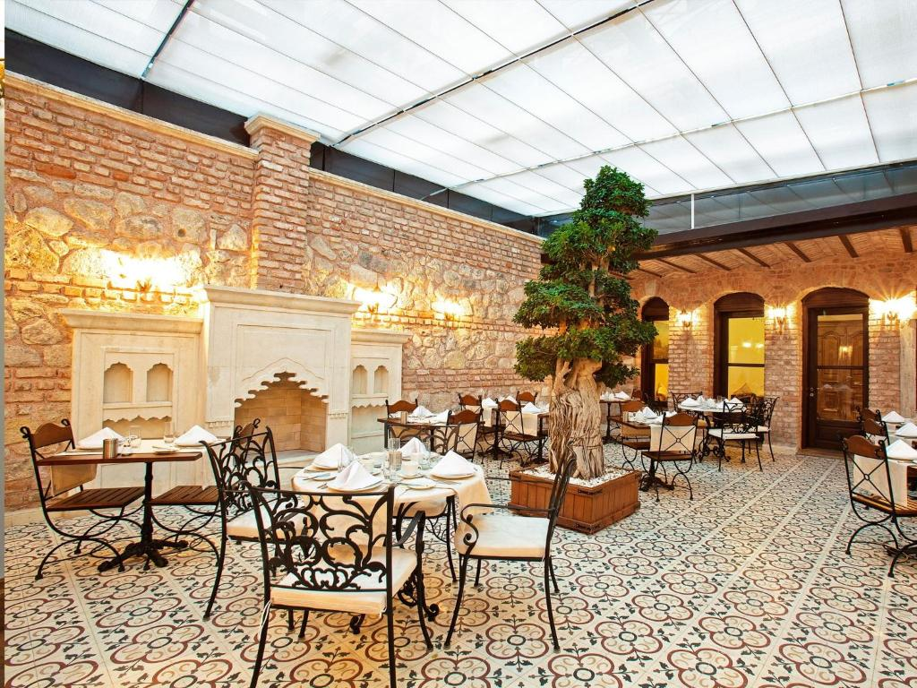 A restaurant or other place to eat at Celine Hotel - Ottoman Mansion