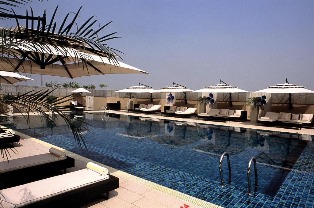 The swimming pool at or near Svelte Hotel and Personal Suites