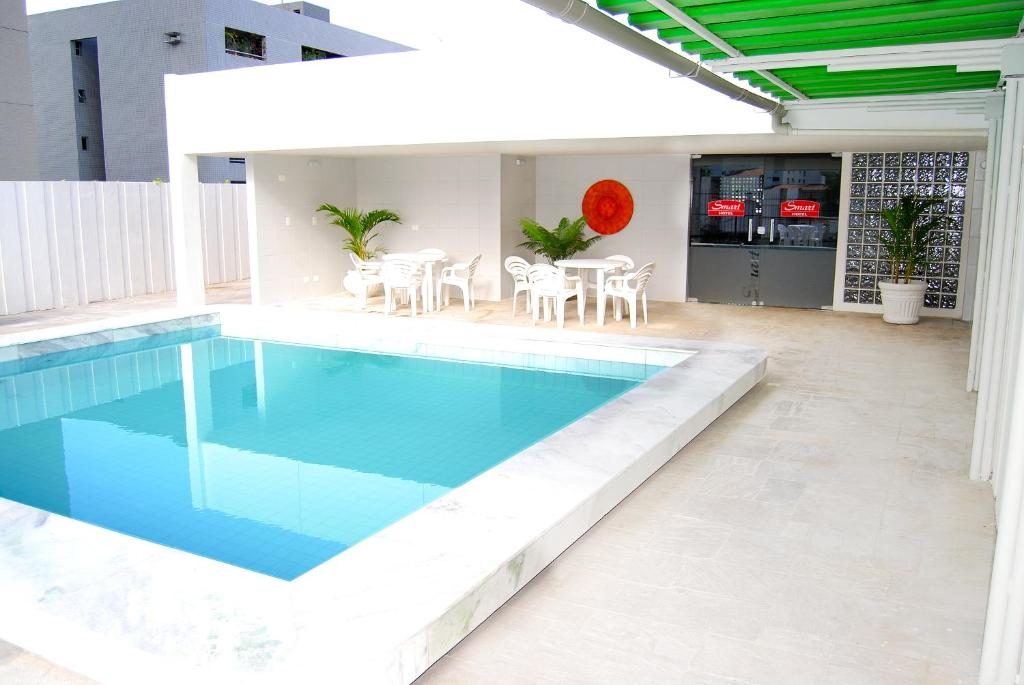 The swimming pool at or near Smart Hotel