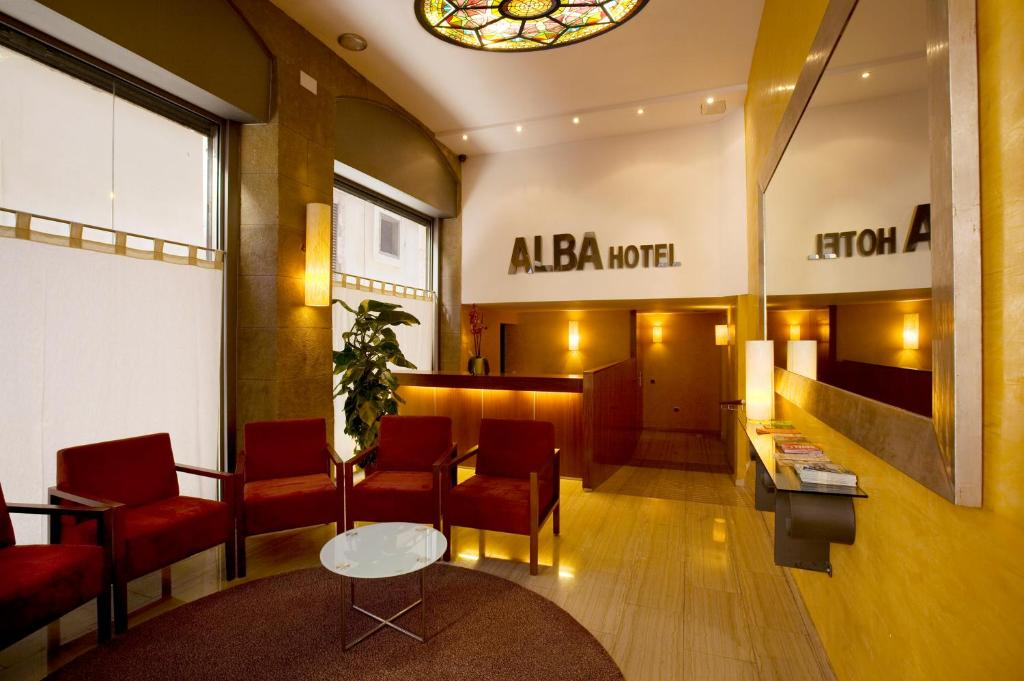A restaurant or other place to eat at Alba Hotel