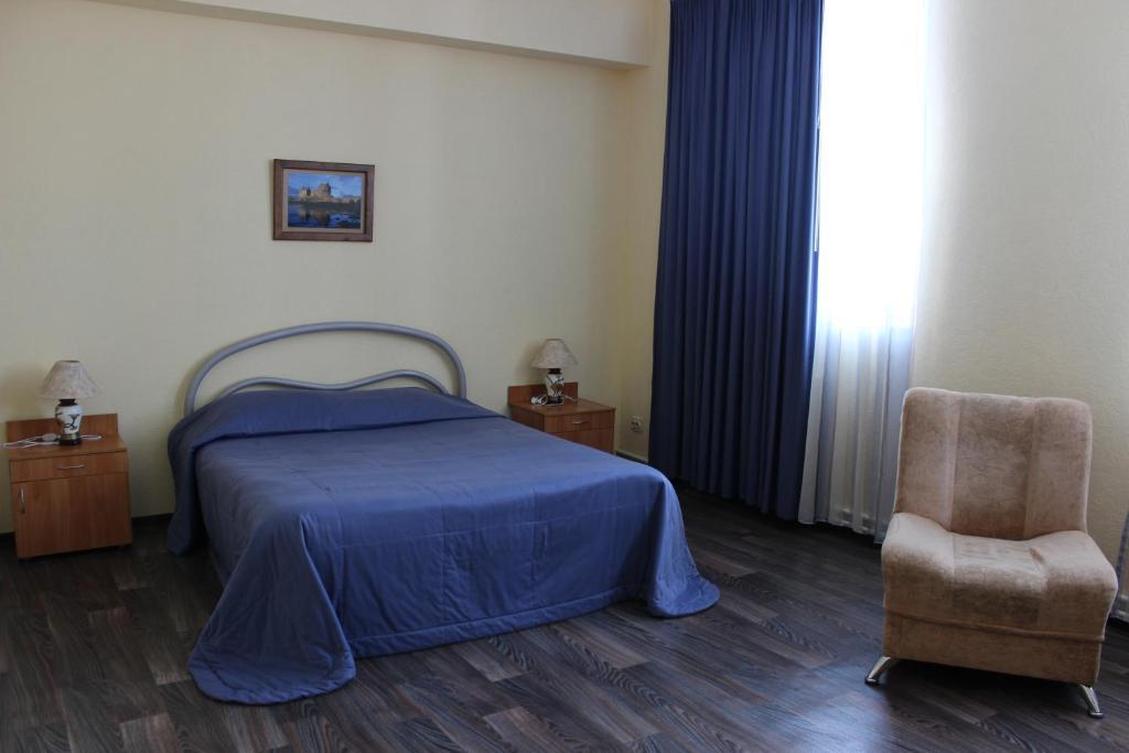 Кровать или кровати в номере Гостиница 12 футов