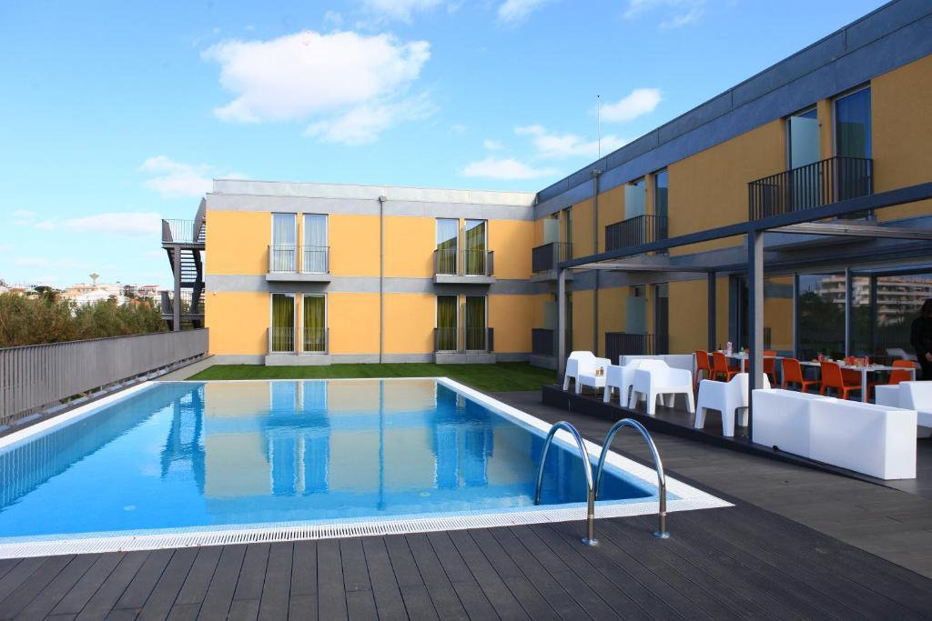 The swimming pool at or near Hotel 3K Faro Aeroporto