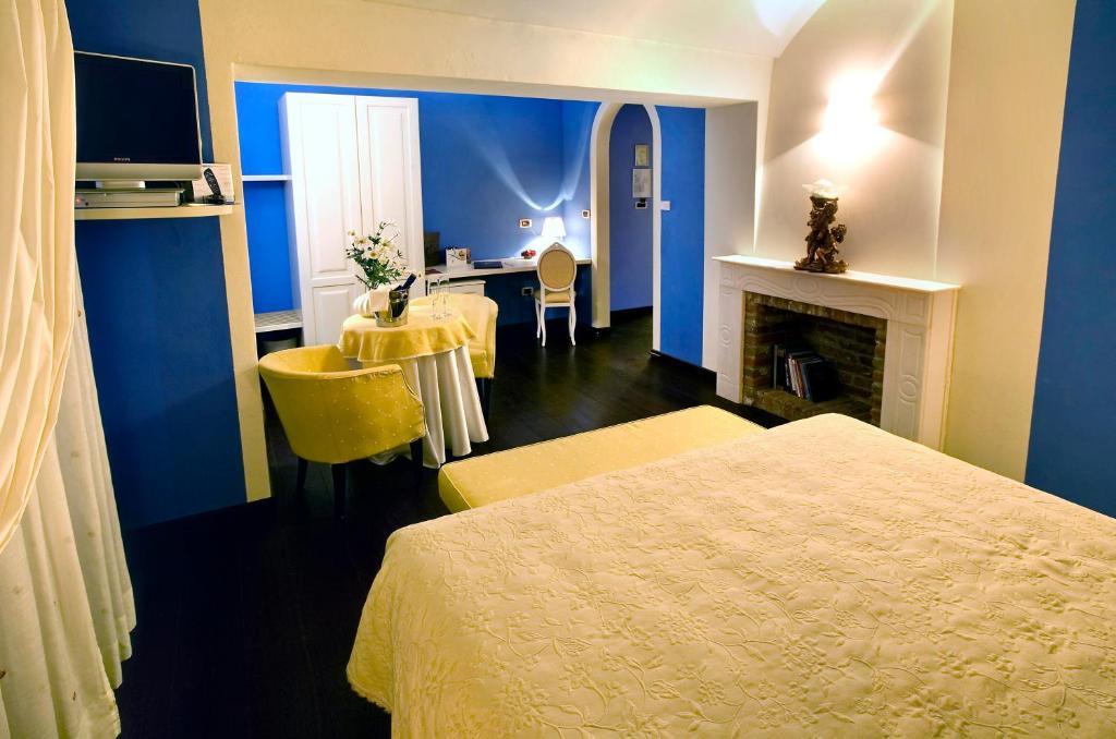 Ein Bett oder Betten in einem Zimmer der Unterkunft Hotel Cascina Di Corte