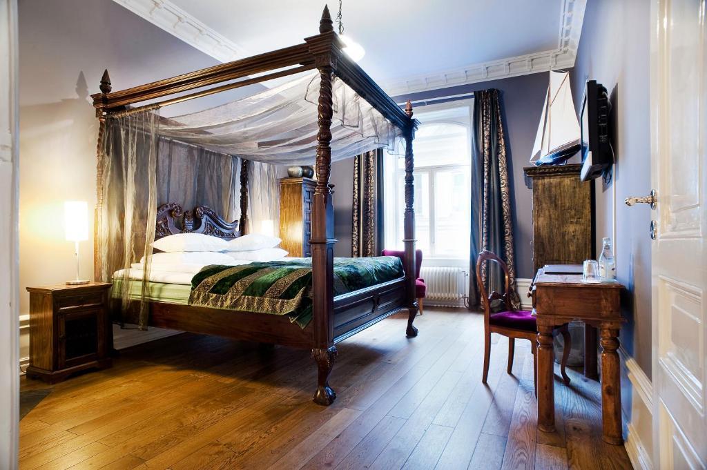 Lova arba lovos apgyvendinimo įstaigoje Hotel Hellsten