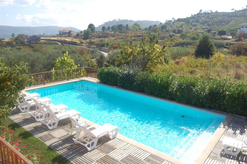 A view of the pool at Outros Tempos - Turismo de Aldeia or nearby