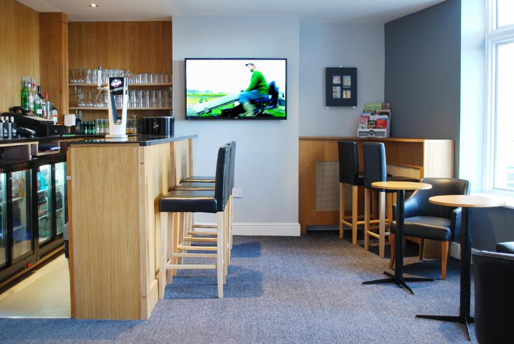 A television and/or entertainment centre at The Liverpool Inn Hotel
