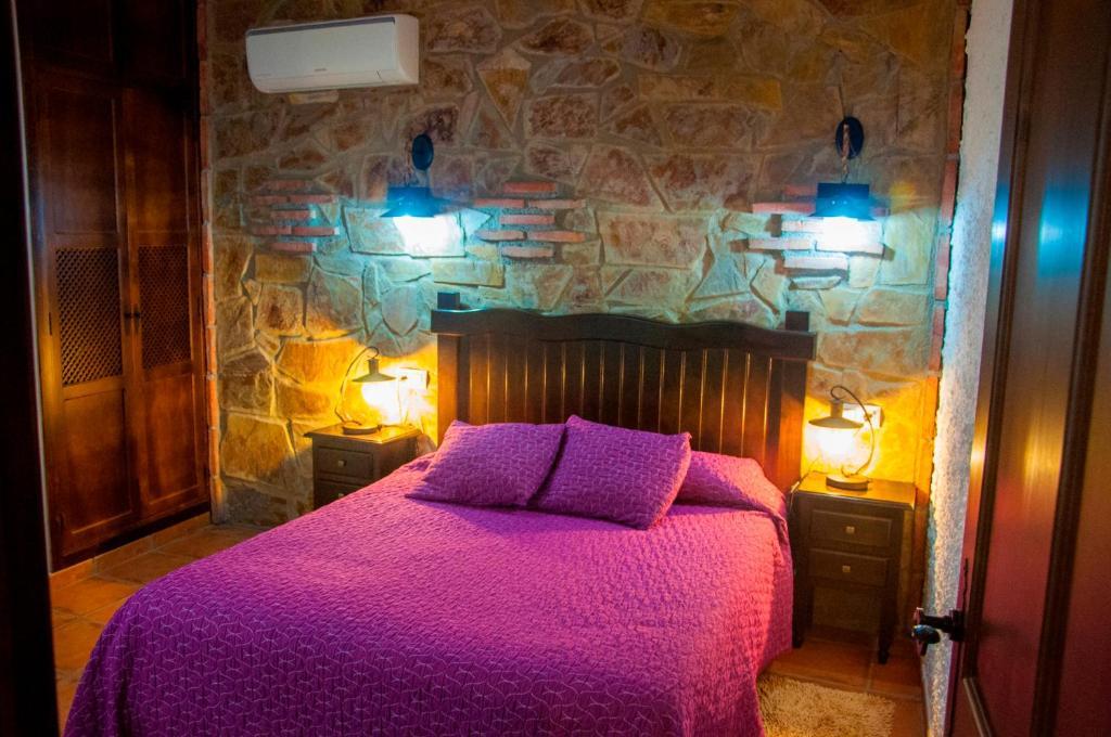 Cama o camas de una habitación en Apartamentos Rurales Tierras de Granadilla