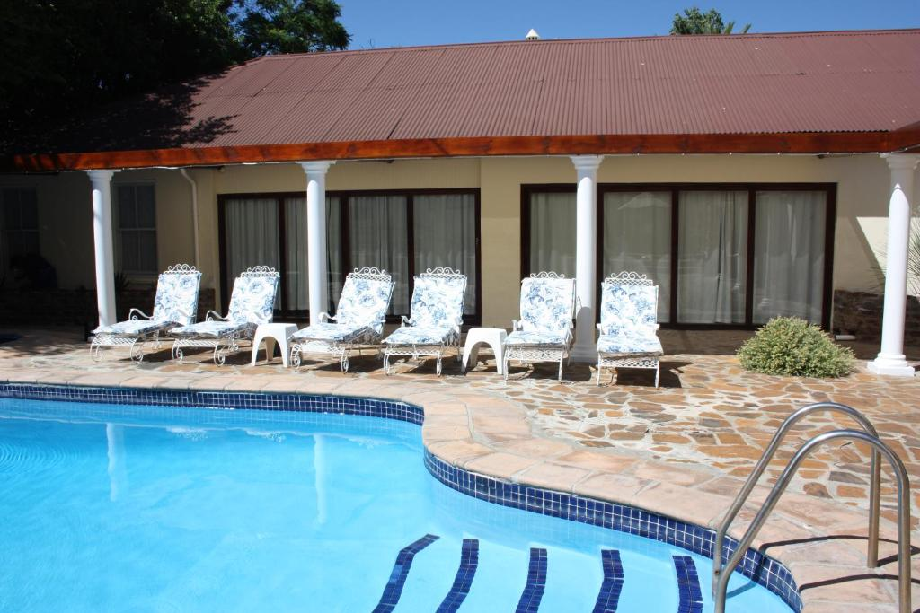 The swimming pool at or near Karoopark Guest House