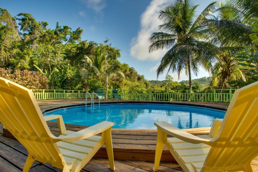 The swimming pool at or close to Maya Mountain Lodge
