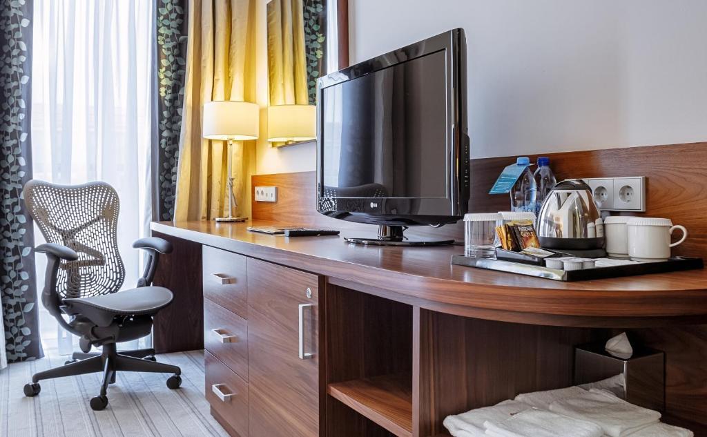 Телевизор и/или развлекательный центр в Hilton Garden Inn Krasnodar