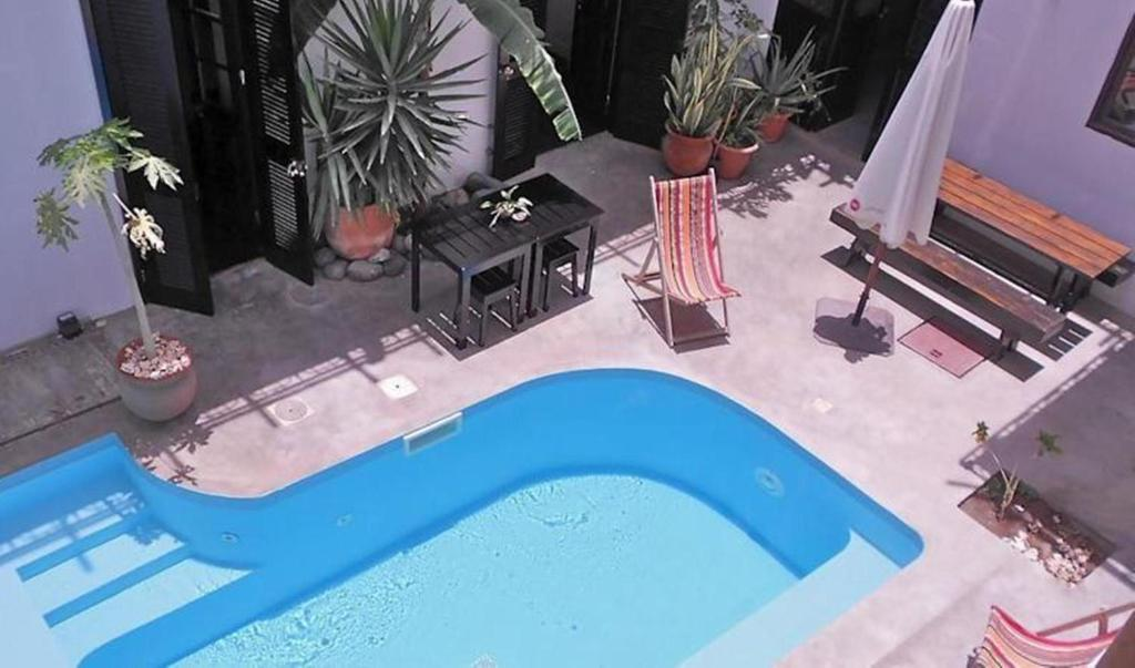 A view of the pool at Casa Colonial or nearby