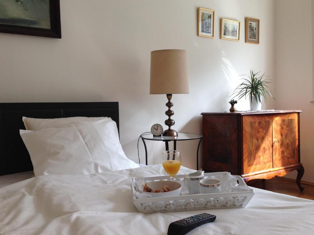 Un ou plusieurs lits dans un hébergement de l'établissement City Classic Apartment