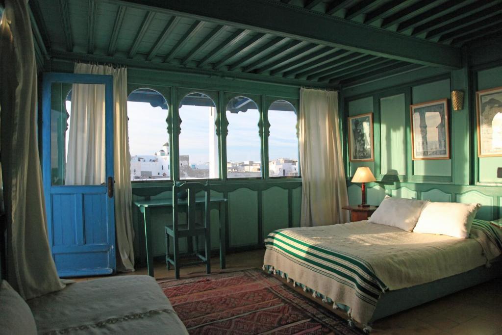 Cama o camas de una habitación en Palazzo Desdemona