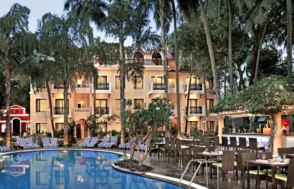 The swimming pool at or near Phoenix Park Inn Goa