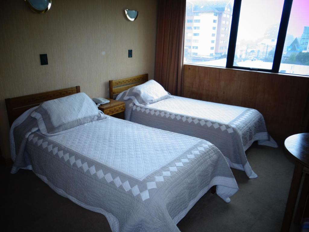 Cama o camas de una habitación en Hotel Antupiren