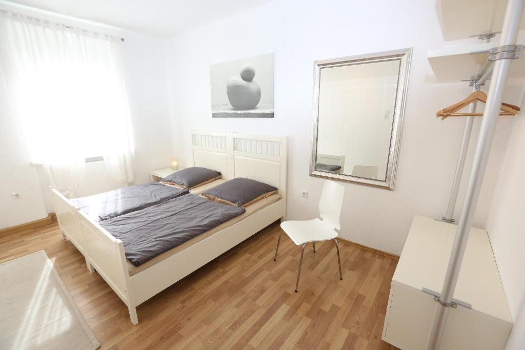 A bed or beds in a room at Apartments Thommen